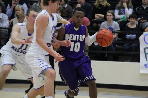 DHS dribbles past Byron Nelson