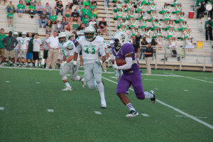 Deavonte Doucet tries to outrun a Lake Dallas defender in Friday