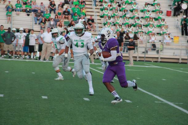 Deavonte Doucet tries to outrun a Lake Dallas defender in Friday's district 5-4A opener. The Broncos dropped the contest 42-28.