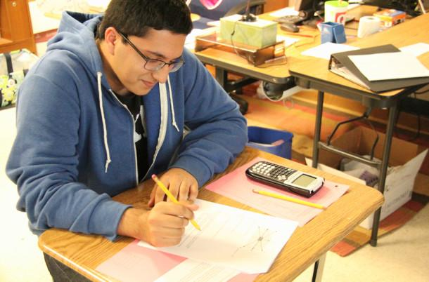 Doing+a+math+assignment+during+class+is+Omar+Akram.+Omar+was+the+schools+lone+student+in+advancing+in+the+National+Merit+process.