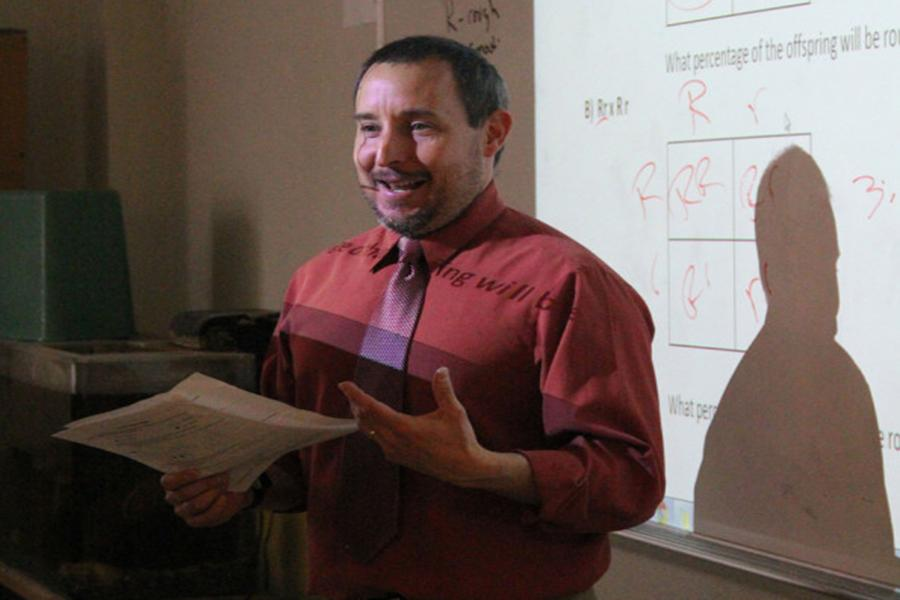 Soccer coach and science teacher Scott Heffley instructs his students in a lesson on Tuesday.