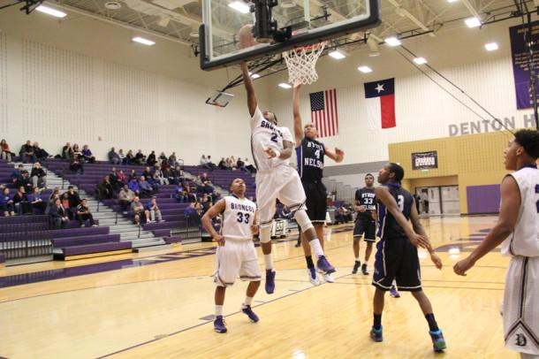 Adarian Harris goes up for a lay up in the teams season finale against Byron Nelson. The Broncos who were leading by nine in the last three minutes came up just short.