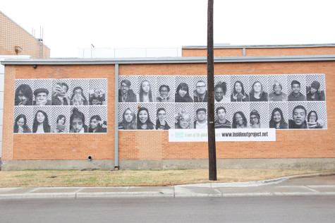 Plastered on the outside of the north wall are the faces of 32 students in Ms. Valery Smith