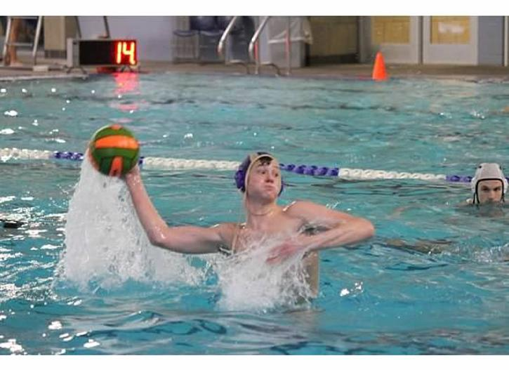 During a recent Water Polo match, Michael Adami scores a goal.