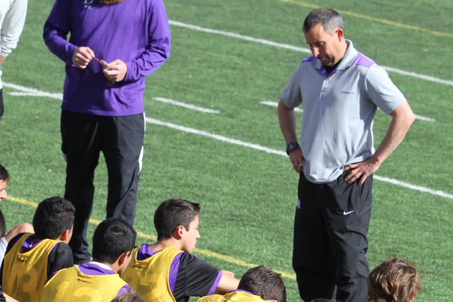 Coach+Heffley+talks+to+the+Varsity+Boys+Soccer+team+during+half+time+at+the+2nd+round+of+the+soccer+playoff+games+on+March+27th%2C+2014.