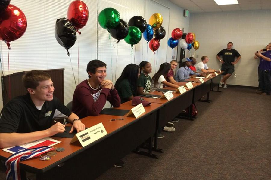 Nine+Bronco+athletes+from+spring+sports+sign+to+colleges.+The+event+was+coordinated+by+the+Denton+High+Counselors.