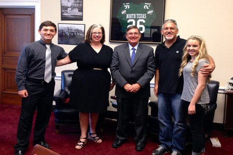 Junior Josh Boring poses with congressman Michael Burgess, as well as IB coordinator Beth Hughes, principal Dan Ford, and Ford's daughter Madelynne, a sophomore.