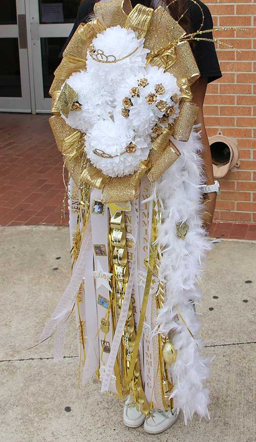 A student displays her oversized mum at last year's homecoming carnival.