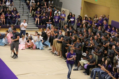 Senior football player Rowdy Clark is given a standing ovation by his teammates as he approaches the microphone to speak during a pep rally.