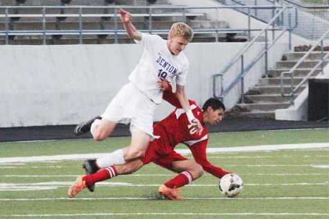 Varsity Offender, Zach Alspach (19) attempts to fight an Eagle defender to gain control of the ball.