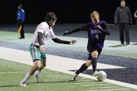Junior Wes Kohler dribbles past a Hornet defender during the Broncos
