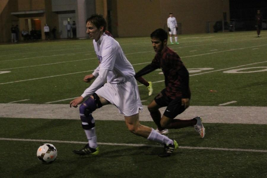 Senior Braeden Petrie chases past a Rough Rider defender during the Broncos' win Monday vs . Saginaw.