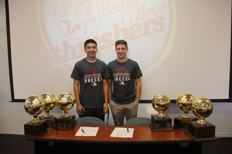 Soccer Captains Chris Torres and Chandler Page pose for the camera after signing letters of intent to Bethel College in Kansas.