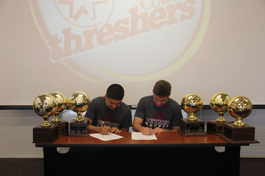 Soccer Captains Chris Torres and Chandler Page sign their letters of intent to Bethel College in Kansas.
