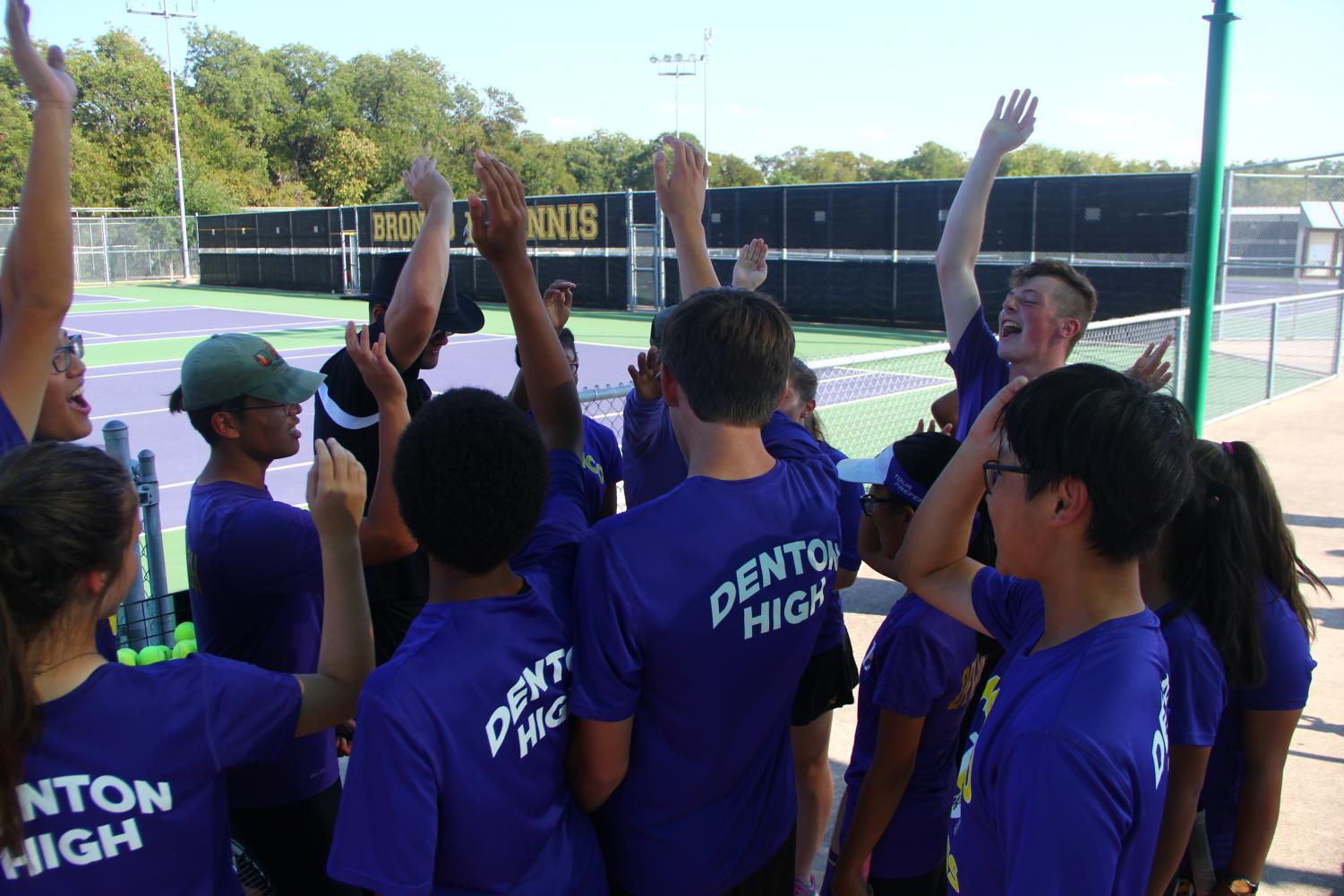The Tennis team breaks out before a game.